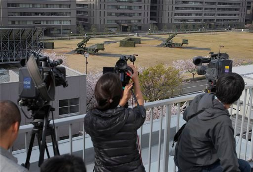 Cameramen stand by to cover the PAC-3 surface to air missile units at the Defense Ministry in Tokyo, Japan, Friday, April 13, 2012. (AP Photo/Itsuo Inouye)