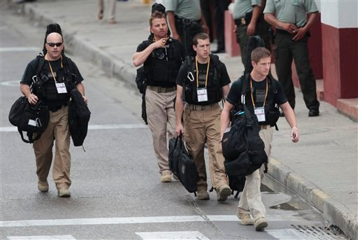 U.S. secret service agents walk around the Convention Center in Cartagena, Colombia, prior to the opening ceremony of the 6th Summit of the Americas at the Convention Center in Cartagena, Colombia, Saturday, April 14, 2012. (AP)