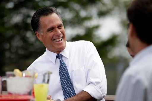 Republican presidential candidate, former Massachusetts Gov. Mitt Romney shares a laugh while meeting with a group of Pittsburgh area residents in Bethel Park, Pa., Tuesday, April 17, 2012. (AP Photo/Jae C. Hong)