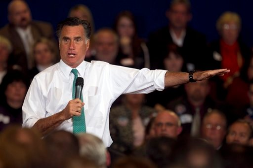 In this April 11, 2012, file photo, Republican presidential candidate, former Massachusetts Gov. Mitt Romney, speaks to a crowd during a campaign event, in Warwick, R.I. (AP Photo/Steven Senne, File)