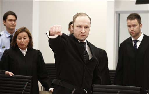 Accused Norwegian Anders Behring Breivik gestures between his defence team Vibeke Hein Baera, left, and Odd Ivar Groen, at the courtroom, in Oslo, Norway, Wednesday April 18, 2012. (AP Photo/Lise Aserud/Scanpix Norway/POOL)