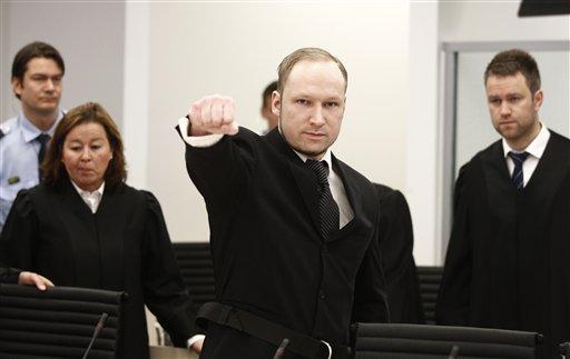 Accused Norwegian Anders Behring Breivik gestures between his defence team Vibeke Hein Baera, left, and Odd Ivar Groen, at the courtroom, in Oslo, Norway, Wednesday April 18, 2012. (AP Photo/Lise Aserud/Scanpix Norway/POOL)