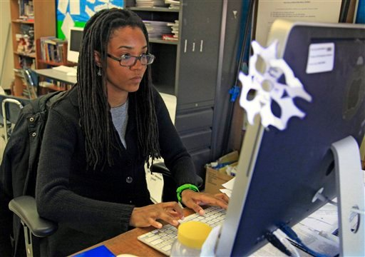 In this April 4, 2012 photo, Nkomo Morris, a teacher at Brooklyn's Art and Media High School, works on her classroom computer in New York. (AP Photo/Bebeto Matthews)