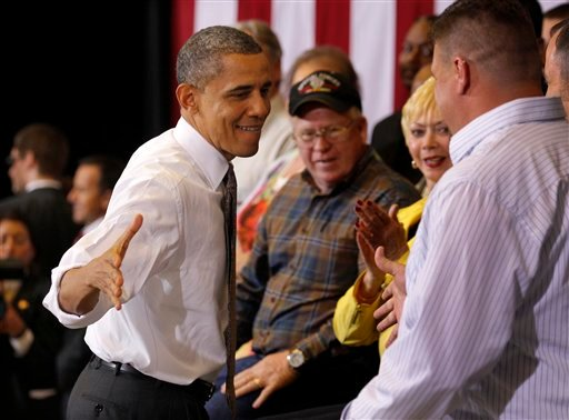 President Barack Obama reaches out to shake hands with Lorain County Community College student Bronson Harwood after speaking at the college in Elyria, Ohio, Wednesday, April 18, 2012. (AP Photo/Amy Sancetta)