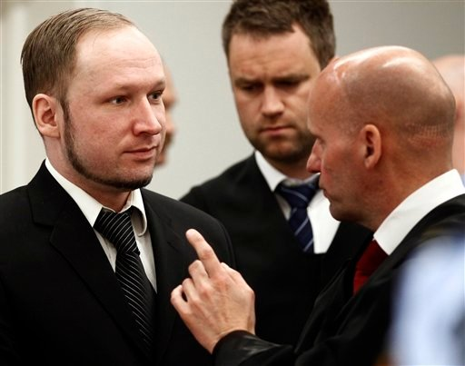 Defendant Anders Behring Breivik with his lawyers Geir Lippestad right and Odd Ivar Groen during the third day of proceedings in courtroom 250 in the courthouse in Oslo Wednesday April 18, 2012. (AP Photo/ Lise Aserud, Pool)