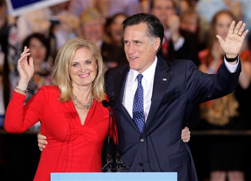 In this photo taken March 20, 2012, Republican presidential candidate, former Massachusetts Gov. Mitt Romney and his wife Ann wave as they leave at an election night rally in Schaumburg, Ill. (AP Photo/Nam Y. Huh)