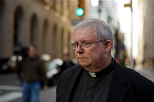 In this Tuesday, March 27, 2012 photo, Monsignor William Lynn leaves the Criminal Justice Center, in Philadelphia. (AP Photo/Matt Rourke)