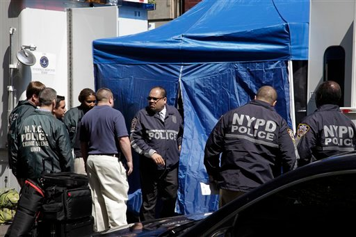FBI and NYPD law enforcement officials search a SoHo basement at the corner of Wooster and Prince streets for the possible remains of missing child Etan Patz on Thursday, April 19, 2012 in New York. (AP Photo/Bebeto Matthews)