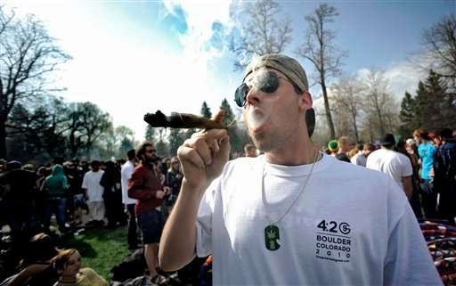 In this April 20, 2009 file photo Garrett Kramer smokes marijuana during the 420 event on Norlin Quad at the University of Colorado in Boulder, Colo.