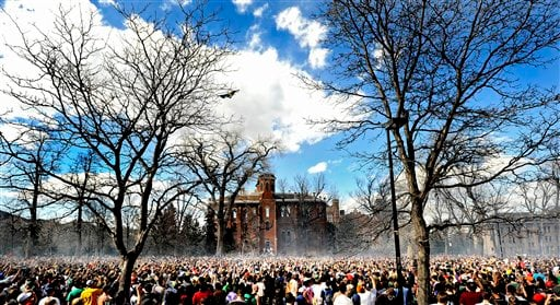 """In this April 20, 2009 file photo thousands of people fill Norlin Quad during the annual """"420"""" event at the University of Colorado in Boulder, Colo."""