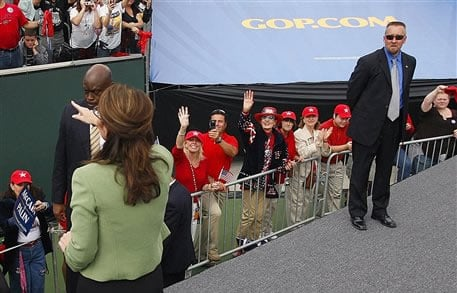 In this photo taken Oct. 4, 2008, David Chaney, right, who identified himself on his Facebook account as a member of Republican Vice Presidential candidate Sarah Palin's Secret Service detail, watches Palin during a rally in Carson, Calif.