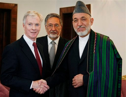 In this Monday, July 25, 2011 file image made available from the Afghanistan Presidential Palace, Afghan President Hamid Karzai, center, shakes hand with new U.S. ambassador to Afghanistan Ryan Crocker at the Presidential Palace in Kabul, Afghanistan. (AP