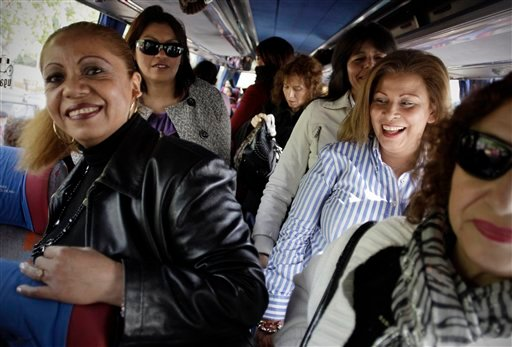 In this photo taken Saturday April 21, 2012, a group of women arrive in a bus before a meeting between men and women at the village of Candeleda, central Spain. (AP)