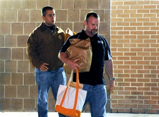 George Zimmerman, left, walks out of the intake building at the John E. Polk Correctional Facility with an unidentified man on Sunday, April 22, 2012, in Sanford, Fla. (AP)