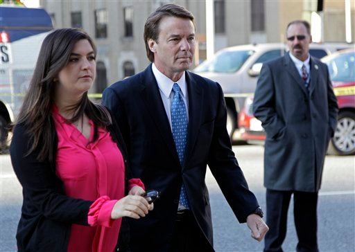 Former presidential candidate and U.S. Sen. John Edwards, center, arrives outside federal court with his daughter Cate, left, in Greensboro, N.C., for his trial on charges of violating federal campaign finance laws, Monday, April 23, 2012. (AP)