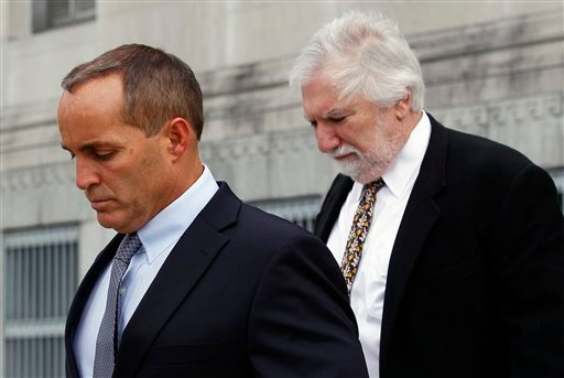 Andrew Young, former aide to former U.S. Sen. and presidential candidate John Edwards, leaves federal court with attorney David Geneson, right, in Greensboro, N.C., Monday, April 23, 2012. (AP Photo/Gerry Broome)