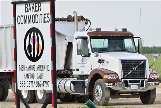 This Tuesday, April 24, 2012, photo shows a truck entering Baker Commodities transfer station, where a cow with mad cow disease was discovered, in Hanford, Calif.