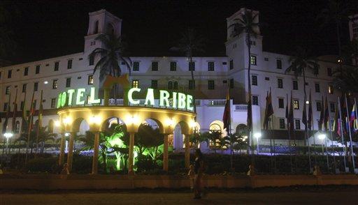 FILE - In this April 19, 2012, file photo, people walk past Hotel El Caribe in Cartagena, Colombia. (AP Photo/Pedro Mendoza, File)