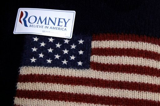 A supporter wears a campaign sticker for Republican presidential candidate, former Massachusetts Gov. Mitt Romney at an election night rally in Manchester, N.H., Tuesday, April 24, 2012. (AP Photo/Jae C. Hong)