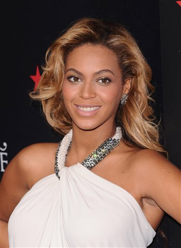 FILE - In this Sept. 22, 2011 file photo, singer Beyonce Knowles makes an appearance at Macy's Herald Square to promote her new fragrance 'Pulse' in New York. People magazine is naming Beyonce as the World's Most Beautiful Woman for 2012.