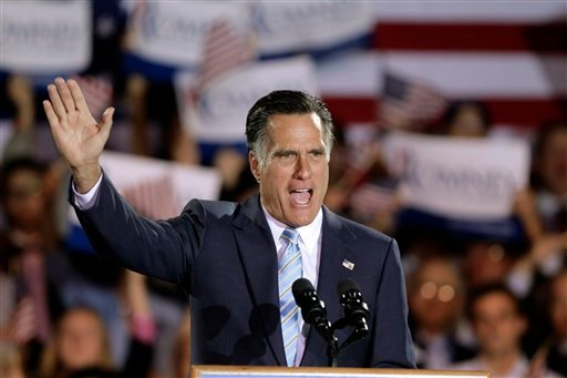 Republican presidential candidate, former Massachusetts Gov. Mitt Romney takes the stage at an election night rally in Manchester, N.H April 24, 2012. (AP Photo/Jae C. Hong)