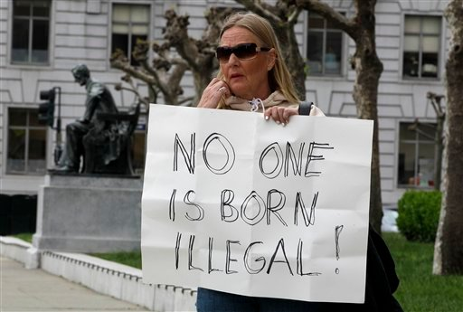 Tuulia Lowe protests against SB1070 and immigration deportations Wednesday, April 25, 2012, in San Francisco. (AP Photo/Ben Margot)