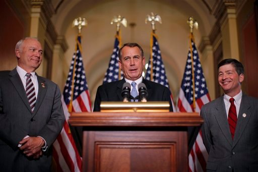 House Speaker John Boehner of Ohio, accompanied by House Education and the Workforce Committee Chairman Rep. John Kline, R-Minn., left, and Rep. Jeb Hensarling, R-Texas, speak about a student loans bill April 25, 2012. (AP Photo/Charles Dharapak)