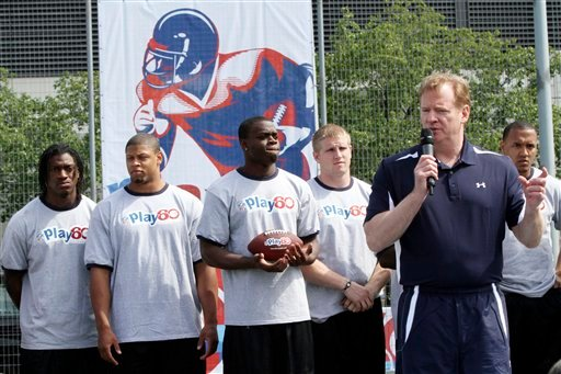 NFL Commissioner Roger Goodell, second from right, addresses the crowd during the NFL Play 60 Youth Football Festival, Wednesday, April 25, 2012, in New York.