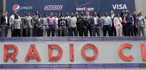 The 2012 NFL draft prospects pose for a group photo atop the Radio City Music Hall's marquee, Wednesday, April 25, 2012, in New York.