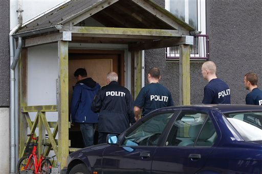 Danish police enter an appartment complex in Herlev, in the outskirts of Copenhagen, Denmark, for a search Friday, April 27, 2012. (AP)