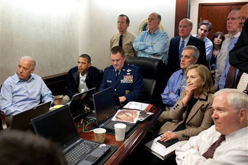 President Barack Obama, second from left, Vice President Joe Biden, left, Secretary of Defense Robert Gates, right, and members of the national security team watch an update on the mission against Osama bin Laden in the Situation Room of the White House.