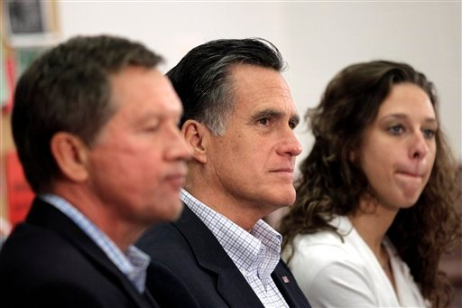 Republican presidential candidate, former Massachusetts Gov. Mitt Romney, accompanied by Ohio Gov. John Kasich, left, and student Kelsey Gorman, listens during a roundtable discussion at Otterbein University in Westerville, Ohio, Friday, April 27, 2012.