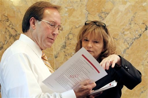 Immigration reform advocate Rep. Becky Currie, R-Brookhaven, right confers with House Education Committee chairman John Moore, R-Brandon at the Capitol in Jackson, Miss., Thursday, April 26, 2012. (AP)