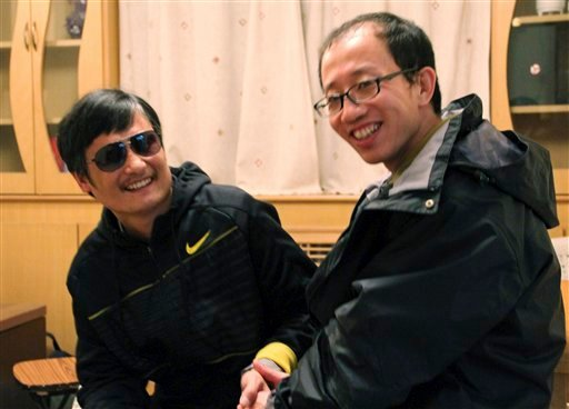 In this photo taken in late April, 2012, and provided by Hu Jia, blind Chinese legal activist Chen Guangcheng, left, meets with Hu at an undisclosed location. (AP)