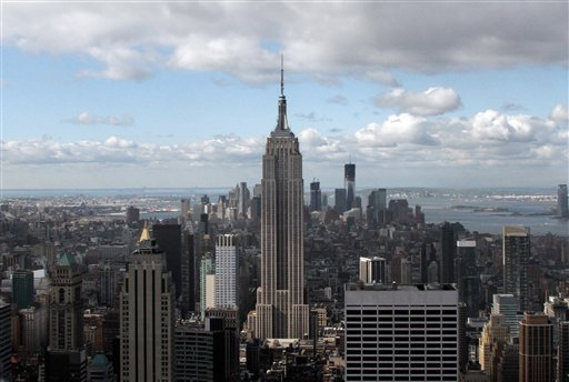 This April 27, 2012, photo shows the Empire State Building, center, and One World Trade Center, rear right, in New York. (AP)