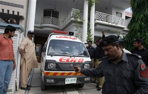 An ambulance removes dead bodies of shooting victims from a house in Lahore, Pakistan on Monday, April 30, 2012. (AP)