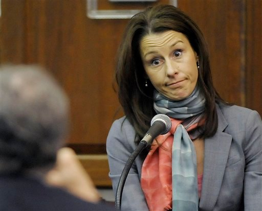 In this Tuesday, March 9, 2010 file photo, Cheri Young, wife of Andrew Young the former aide to former Senator John Edwards, testifies on the existence and location of a disc and missing flash drive during a hearing at the Chatham County Superior Court