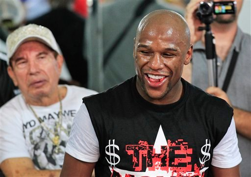 Floyd Mayweather Jr. takes a break during a workout Tuesday, April 24, 2012, in Las Vegas. Mayweather is scheduled to fight Miguel Cotto on May 5.