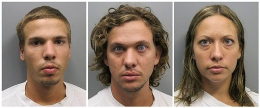 FILE - This photo combo made from file photos provided Wednesday, Aug. 10, 2011 by the Pueblo County Sheriff's Office shows, from left, Ryan Edward Dougherty, 21, Dylan Stanley-Dougherty, 26, and Lee Grace Dougherty, 29.