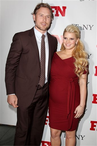 In this Nov. 29, 2011 file photo, singer Jessica Simpson, right, poses with her fiance Eric Johnson at the 25th Annual Footwear News Achievement Awards at The Museum of Modern Art in New York. (AP Photo/Starpix, Amanda Schwab, file)