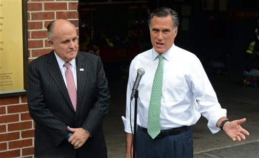 Republican presidential candidate Mitt Romney, accompanied by former New York City Mayor Rudolph Giuliani speaks to the media after touring New York Fire Department Engine 24 Ladder 5, Tuesday, May 1, 2012 in New York. (AP Photo)