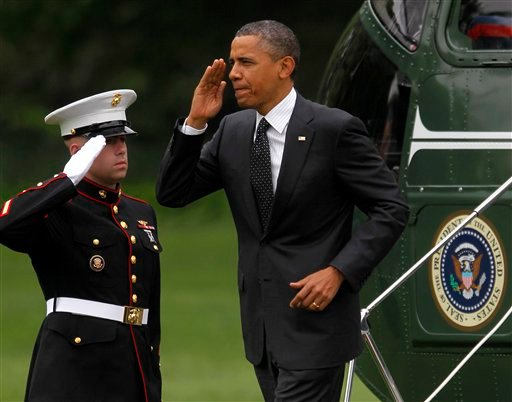 President Barack Obama returns a salute as he steps off the Marine One helicopter upon his arrival on the South Lawn of the White House in Washington, Wednesday, May, 2, 2012. (AP Photo/Pablo Martinez Monsivais)
