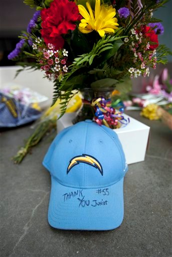"A San Diego Chargers hat with the words ""Thank you, Junior"" sits in front of the doors of former NFL football player Junior Seau's restaurant."