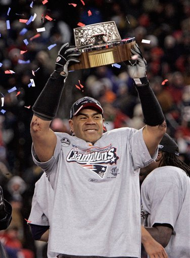 FILE - In this Jan. 20, 2008, file photo, New England Patriots linebacker Junior Seau holds the Lamar Hunt Trophy looks on after defeating the San Diego Chargers 21-12 in the AFC Championship.