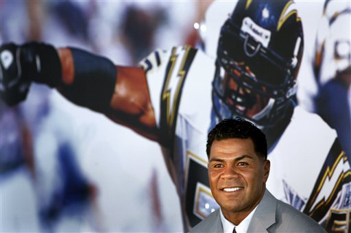 FILE - In this Aug. 14, 2006, file photo, former San Diego Chargers football player Junior Seau smiles during a news conference announcing his retirement from pro football in San Diego.