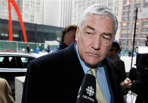 In this Jan. 13, 2011 file photo, former media mogul Conrad Black arrives at the federal building in Chicago. Black was released from a federal prison in Miami early Friday, May 4, 2012 after serving about three years for defrauding investors. (AP Photo/