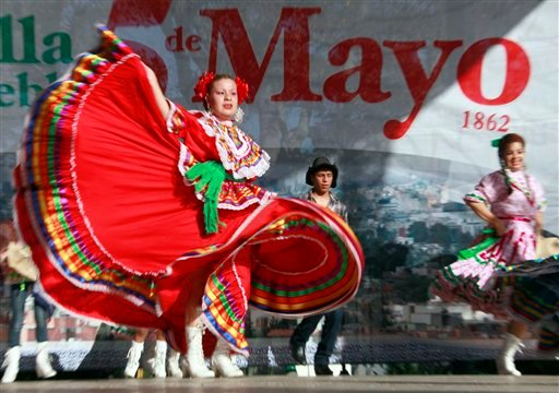 In this May 5, 2011 file photo, Marylin Castillo dances in honor of the Cinco de Mayo celebration in Los Angeles.