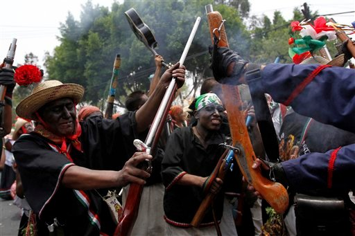 "In this May 5, 2011 file photo, people take part in a recreation of the Battle of Puebla during ""Cinco de Mayo"" celebrations in Mexico City."