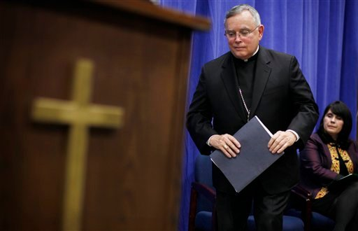 Archbishop of Philadelphia Charles Chaput makes his way to the podium during a news conference Friday, May 4, 2012, in Philadelphia. (AP Photo/Matt Rourke)