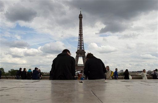 People sit down to admire the view on Eiffel tower Paris Monday May 7, 2012, one day after the second round of the Presidential elections. (AP Photo/Laurent Cipriani)